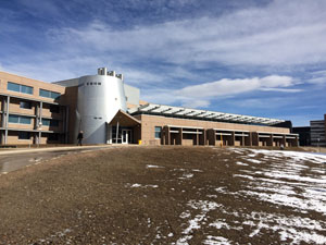"""NREL Science & Technology Facility, Golden, Colorado. This 71,000 square foot office, lab, and mechanical penthouse was the first project to be certified LEED Platinum for the Federal Government.Lab floors require concrete two-way flat plate for vibration requirements. The clear-span steel roof trusses over the office building are an inverted ""V"" shape to accommodate day-lighting requirements."