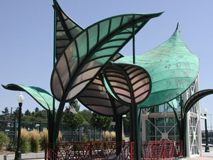 """""""Jurassic Leaves,""""  Denver, Colorado, Light Rail Sculpture/Shelter Structure. The Jurassic Leaves structure is supported on an elevated platform above a rail line."""