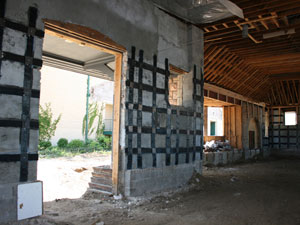 INTERIOR FACE OF EXTERIOR WALLS WERE REINFORCED WITH CARBON FIBER TO STRENGTHEN EXISTING STONE MASONRY WITHOUT ADDING WEIGHT.