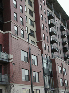 The Manhattan, Central Platte Valley, Denver, Colorado. 12-story Post-Tensioned Concrete Apartment Building, 4-Story Parking Garage with 1 level Below Grade Plaza Level with Swimming Pool, Spa.