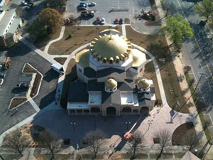 Holy Trinity Greek Orthodox Church, Columbia, South Carolina. The church was designed with structural steel with cold formed metal walls and roof. The 51 ft diameter steel dome structure is 40 ft above the main floor. The octagonal moment frame supports both gravity and lateral loads. The dome was assembled on the ground and lifted into place.