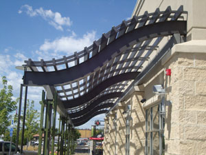 The Gardens on Havana, Aurora, Colorado, Main Street with multiple strip buildings, Multiple Anchor and Jr. Anchor Tenant Buildings, Renovation of existing Target Store, Extensive Landscaping, Public Art Varied Trellis Elements throughout.